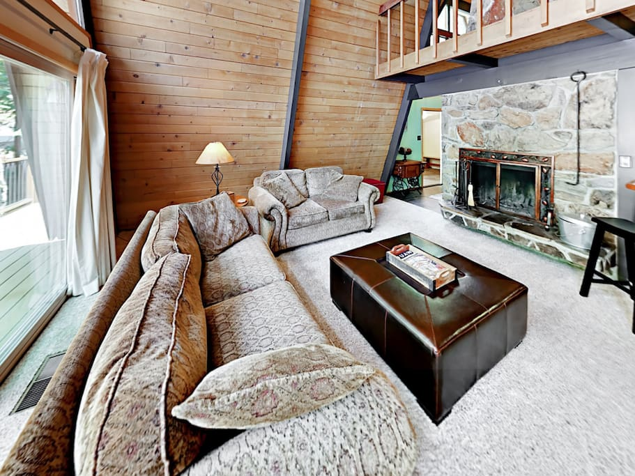 With vaulted ceilings and stone accents, the living spaces in this cabin boast a classic Tahoe feel.