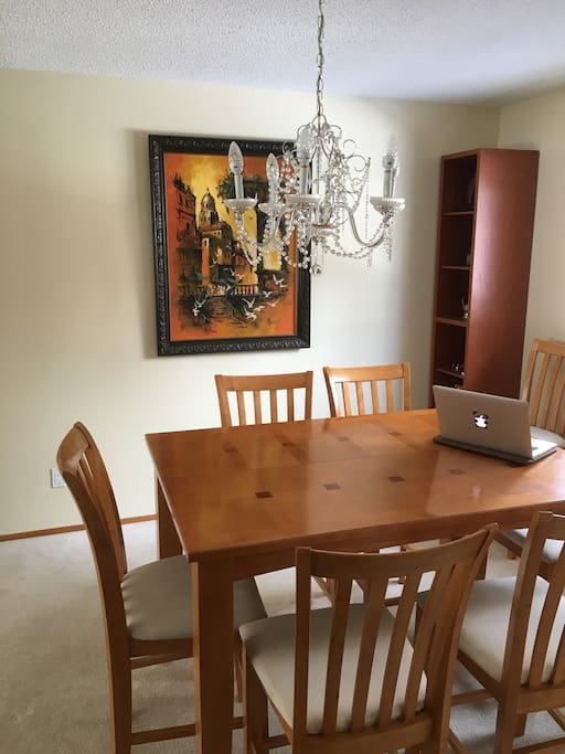 Brightly lit study space or dining room, with an expandable table