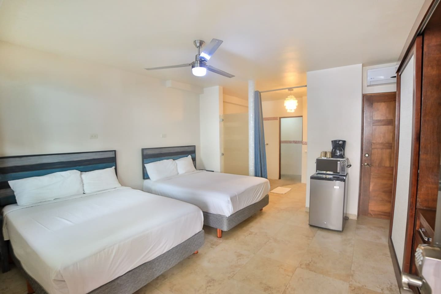 This is the room. It has two double beds, a fridge, microwave, coffee maker, cups, spoons, bottle/wine opener, tv as well as coffee, creamer, sugar and sweetener.