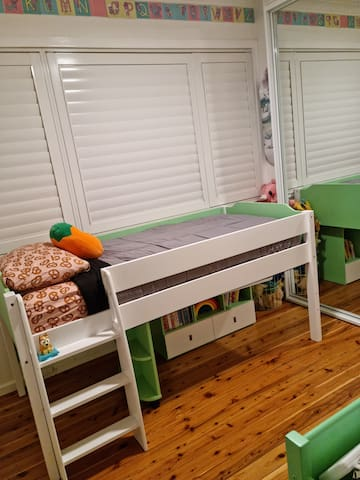 kids loft bed is recommended for 9 years & over. We can place the mattress on the floor if kids are younger. Nappy change table & ceiling fan in room.