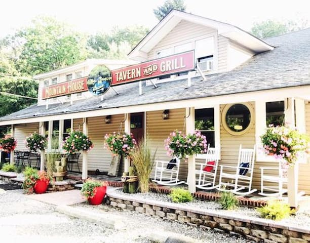 Mountain House Tavern and Grill right up the road - enjoy a drink by the lake on a warm night!