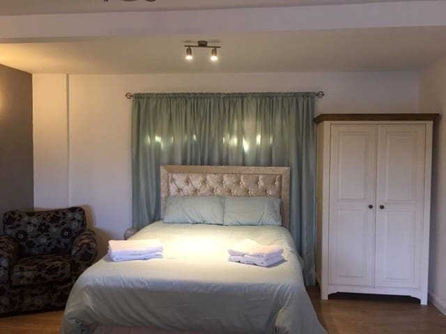 King size bed, plenty of storage and hanging space