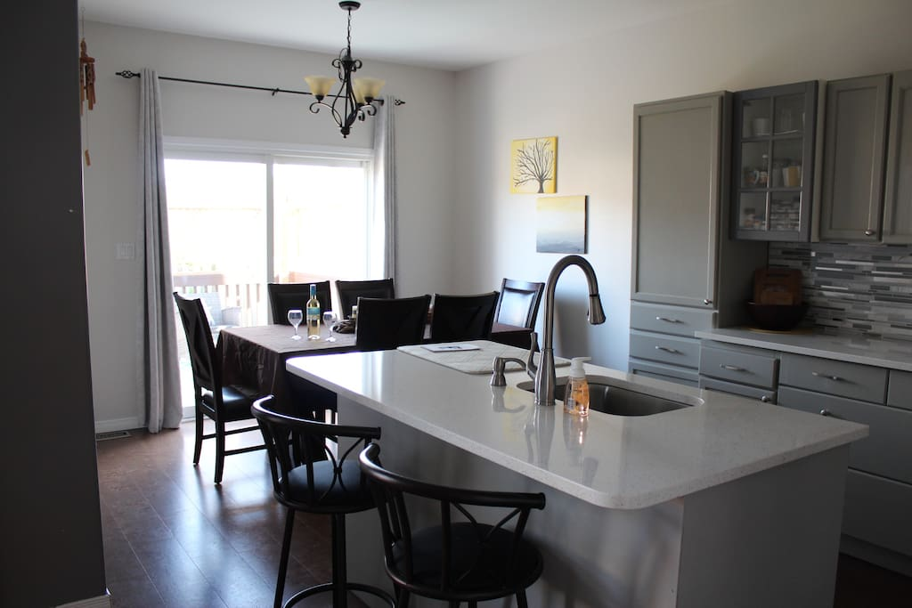Dining/Kitchen combo includes dining for up to 8, plus 2 bar stools at kitchen island. Patio leads to full deck with more room for entertaining