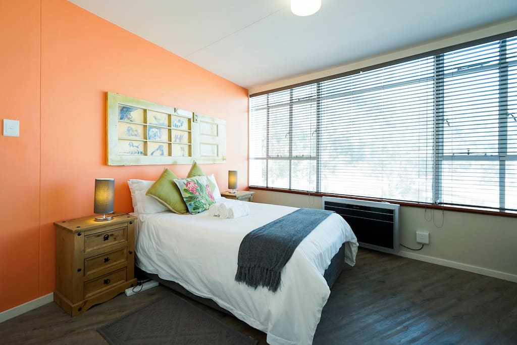 Main bedroom with a great view of Table Mountain. Very comfortable double bed and aircon.