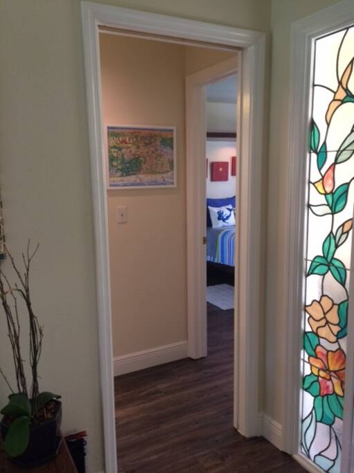 Hallway to private bedroom and bathroom. Pocket door for privacy