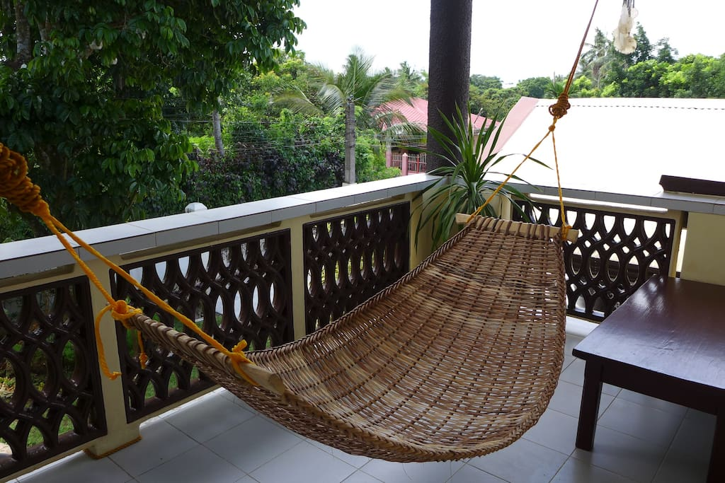Lounge in our hammock with excellent views of the garden and the trees.