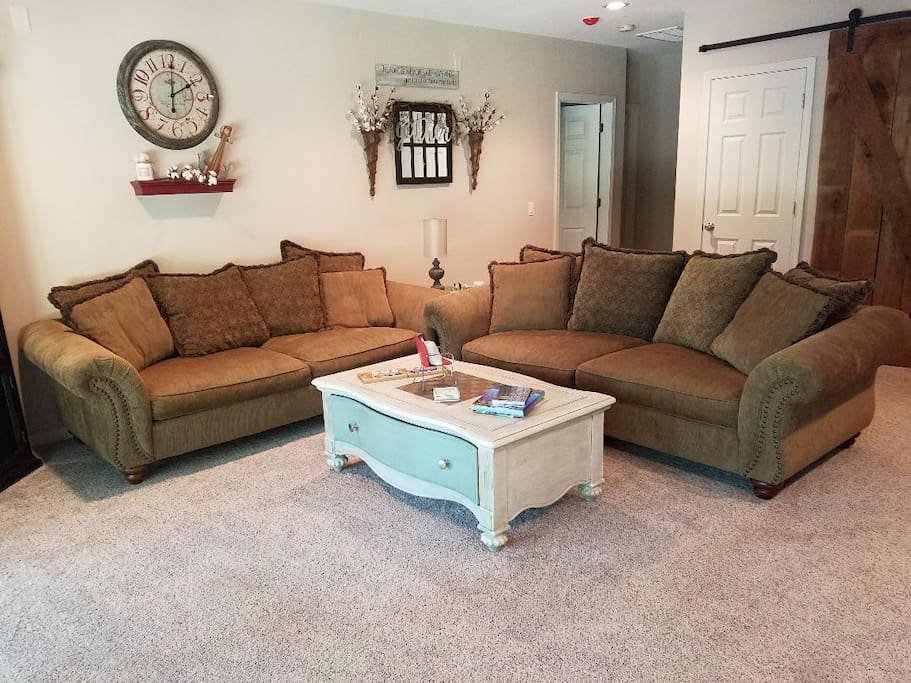 Great room; Two large couches, kitchen table and walkout to the lake