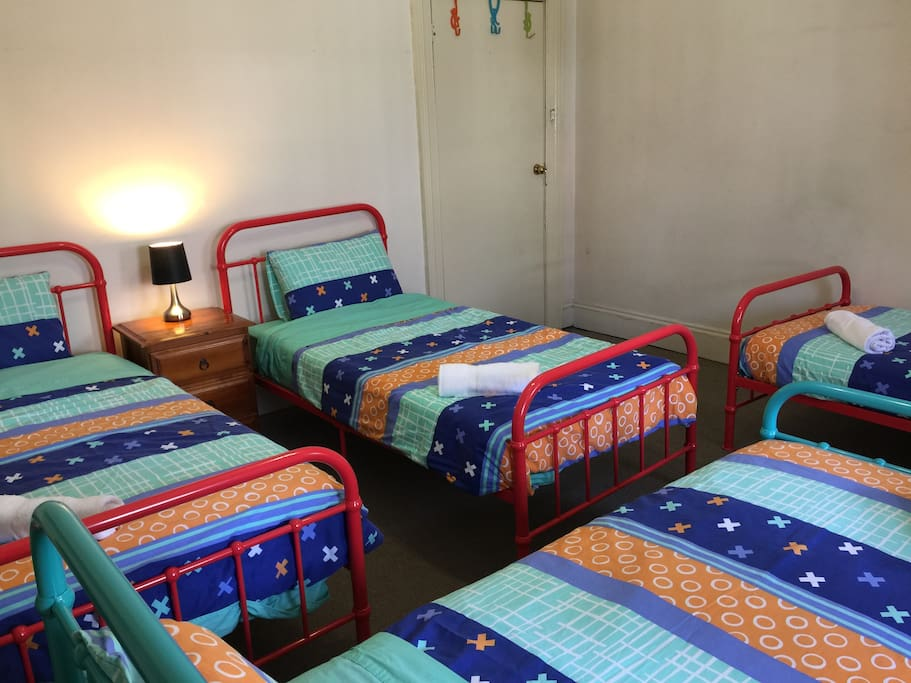 1st room has 4 single beds