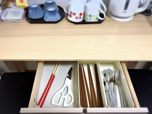 Cups, chopsticks, spoons, forks, scissors, etc.