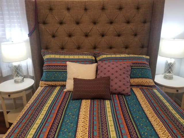 Cozy, comfortable, and luxurious queen size pillow-top bed