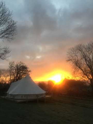 Sunrise and the bell tent