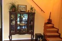 China Cabinet - Stairs lead up to Owner/Occupant.