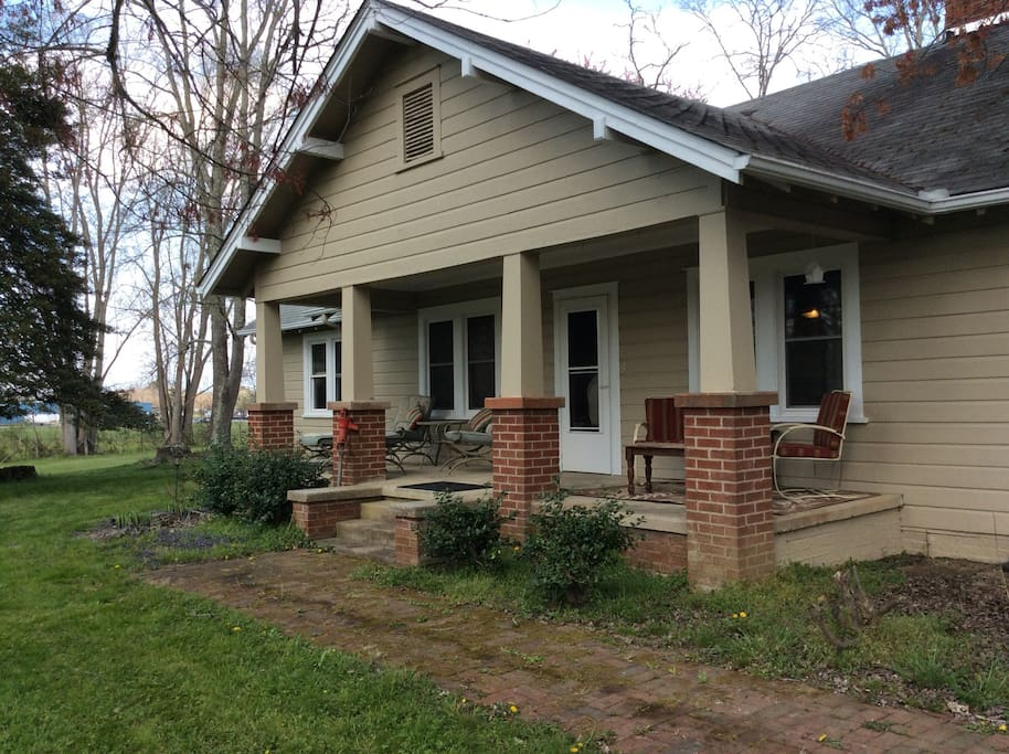 Front porch with plenty of seating.