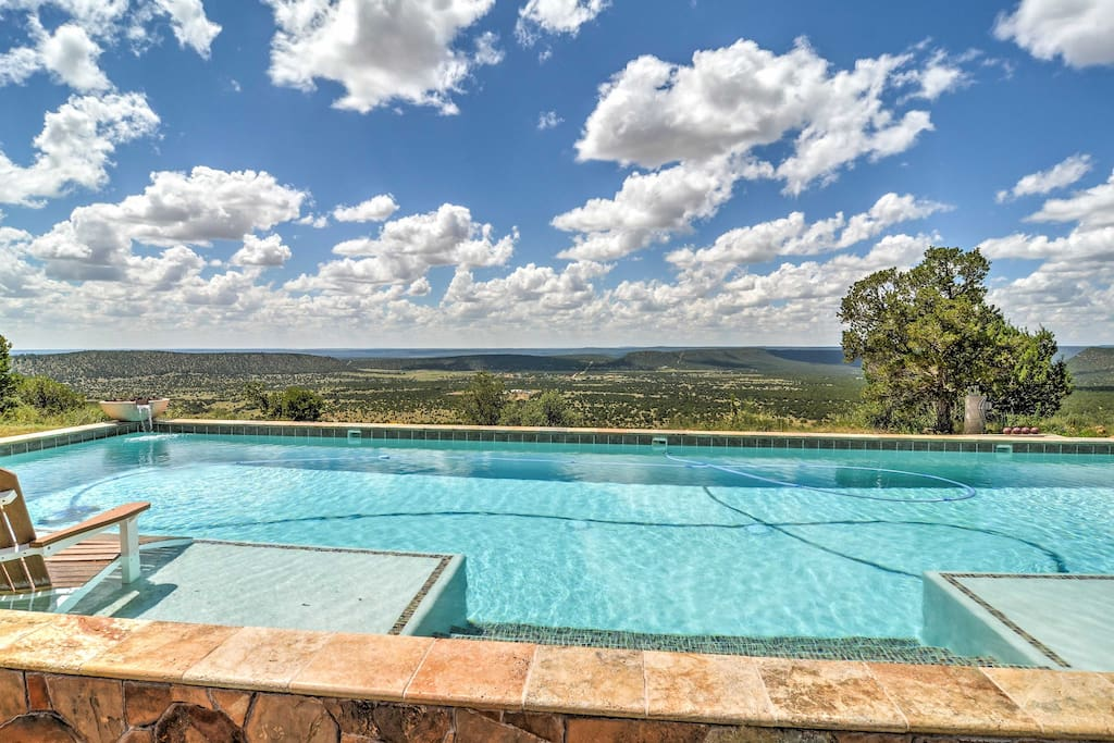 Situated 7,000 feet high, the property features lavish interior and exterior amenities, like a full service gym, a home theater, a caldron hot tub, and a pool with a view!