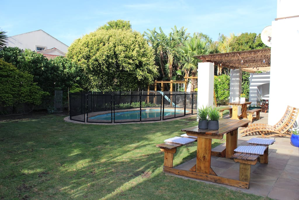Spacious green garden with a secured swimming pool for children. Gate around swimming pool can be removed if required)