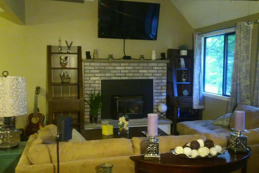 Warm and inviting living room with large sectional and gas fireplace flat screen w/ surround and blu ray dvd