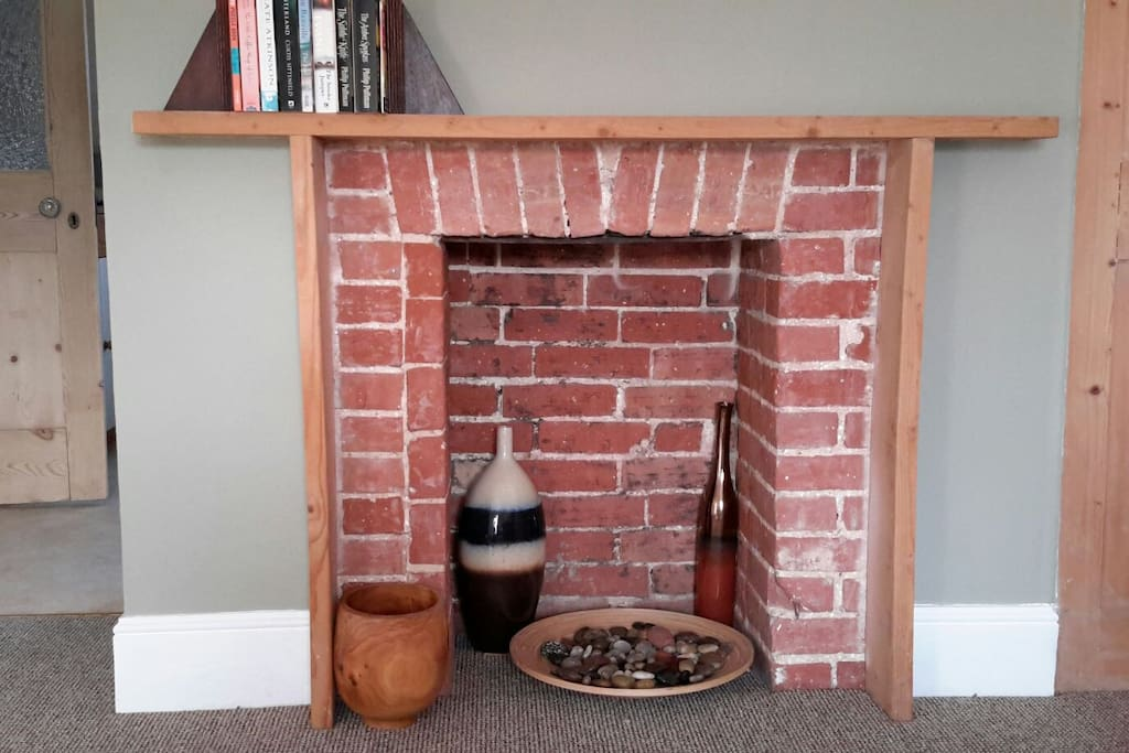 Fireplace in the sitting room, looks good, but sadly is not in use.