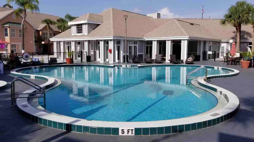 View of the pool and the clubhouse behind