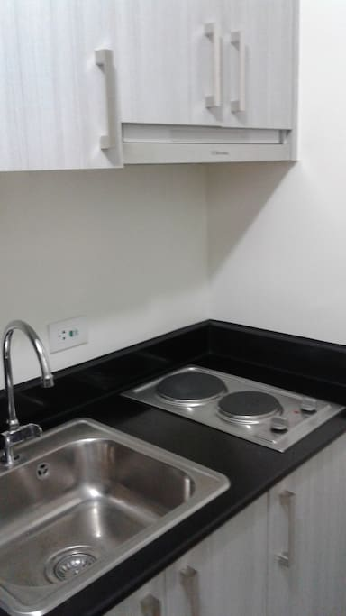 Kitchen sink and Electric stove