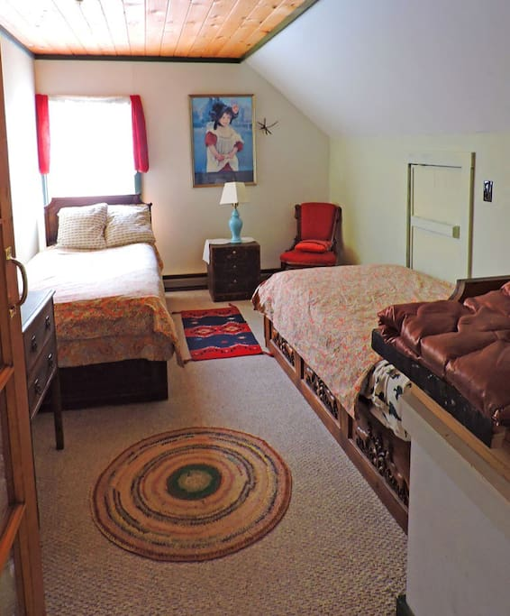 two twin beds in a shared bedroom