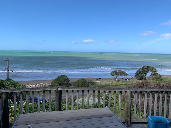 Kiwi Bach at Akitio by the beach