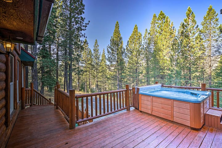 The spacious deck is home to a hot tub.