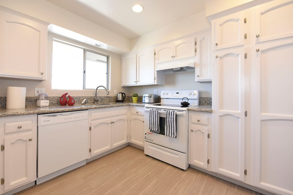 large full kitchen with all the kitchenware you need.