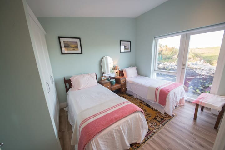 Bedroom three has two twin beds that can be converted to a king size bed upon request. En suite has walk in shower with rain shower head.