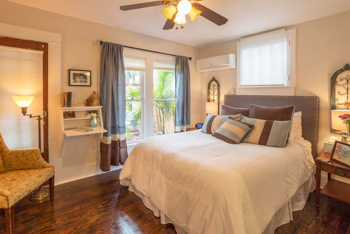 The one Master bedroom in the cottage,  the most commented on bed in the site.  Linens are high quality soft and plush for you to enjoy after a long day at the beach.