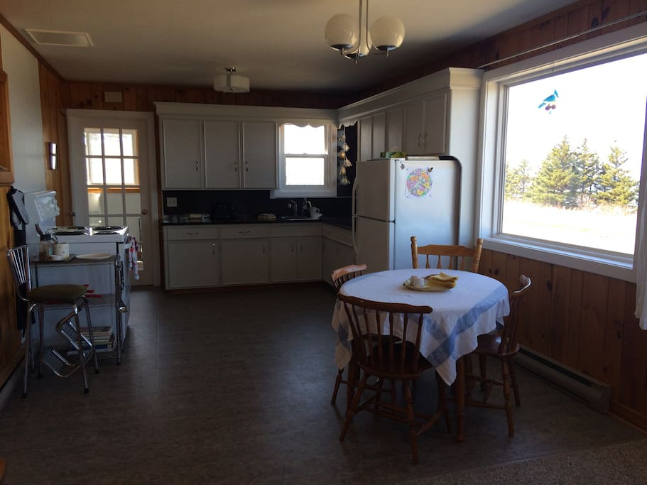 The open kitchen has plenty of space for all the cooks in the family.