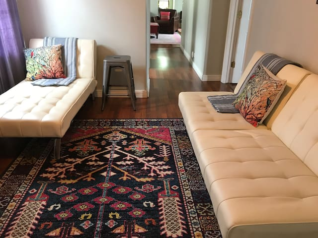 It's great being together, until you need a little space! Spread out between the front and back sitting areas.  Couches convert to beds. Hallway passes two baths on the way to living room, dining room and kitchen.