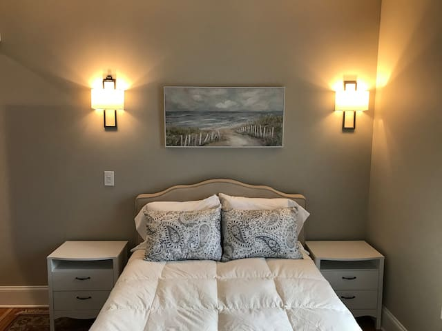 Fluffy pillows, lighting for reading at night with switch on wall near nightstand.  Calm colors on the walls and for decorating.