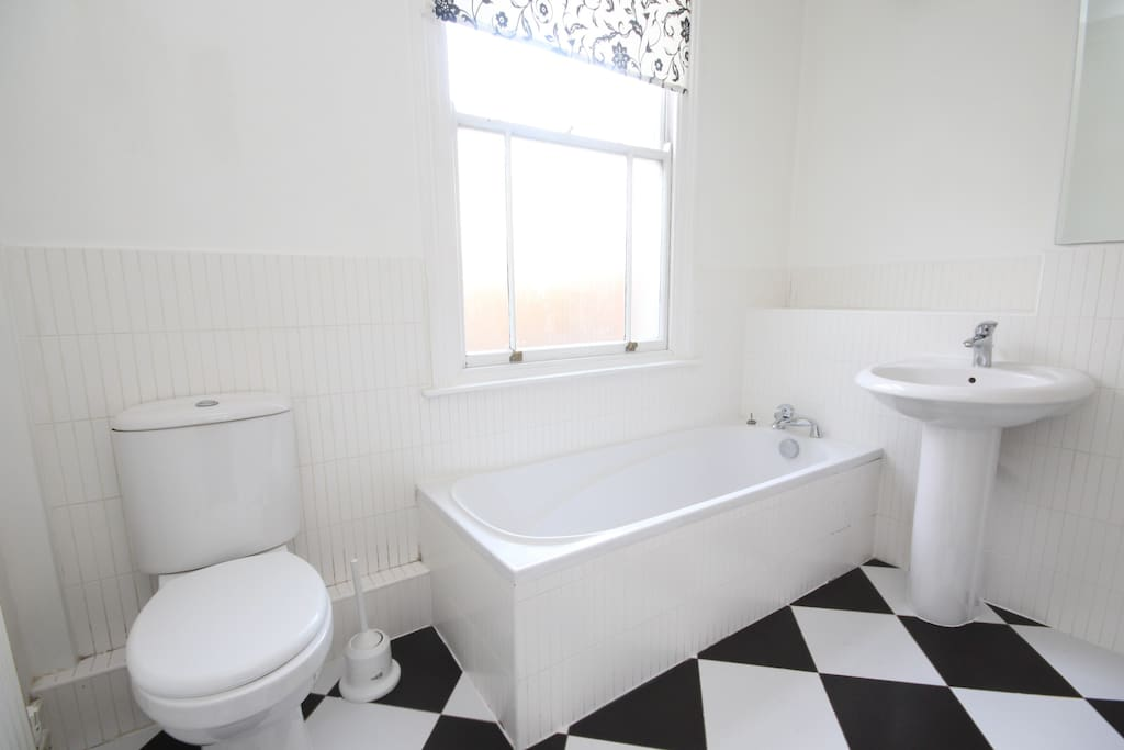 Bathroom with walk in shower to the right of sink