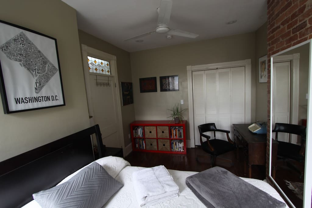 Bedroom with desk, night stand and book shelf