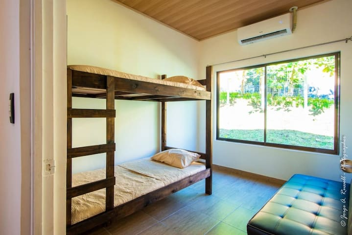 3rd bedroom - Wood bunkbeds & a Sofa bed with a wide window.
