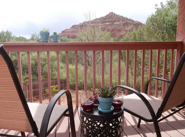 Private outdoor deck with a view of pyramid mountain. Perfect for stargazing or sipping your morning coffee!