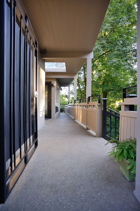 Gated access to lower unit stairs.