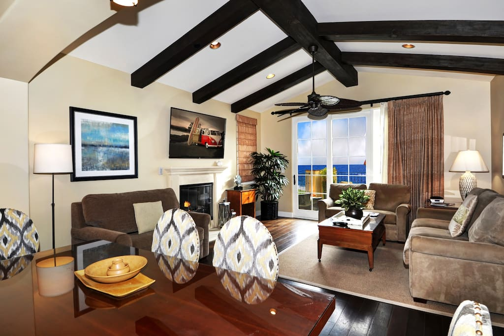 Spacious & open great room with dining, fireplace, HDTV, & large ocean view deck