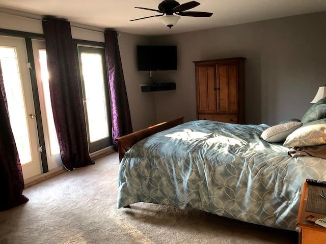 Bedroom 1 (master, queen) upstairs with balcony, TV