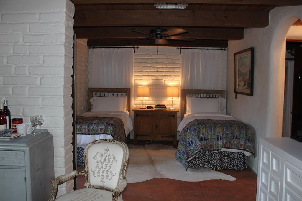 Twin Beds with Cowhide Rug