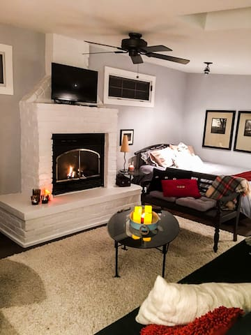 Elegantly styled living room for TV night or cuddling by the fire.
