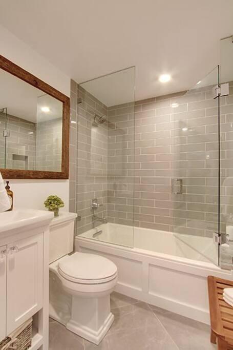 Modern bath with spa-like shower/tub and frameless glass door!