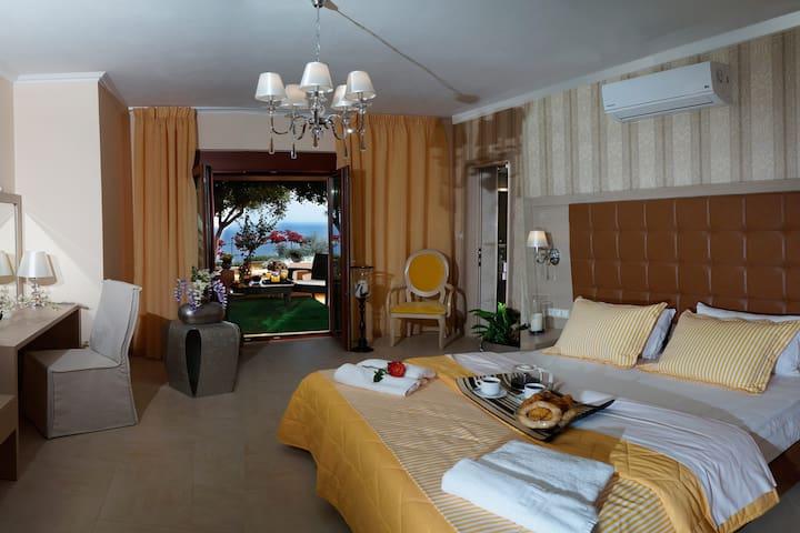 Bedroom with en-suite bathroom on the lower floor and direct outdoor access.
