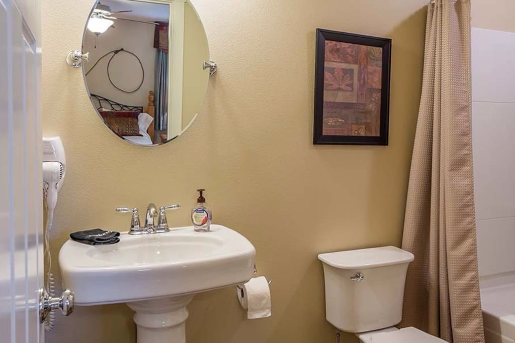 Clean and Shiny Bathroom with Tub/Shower.