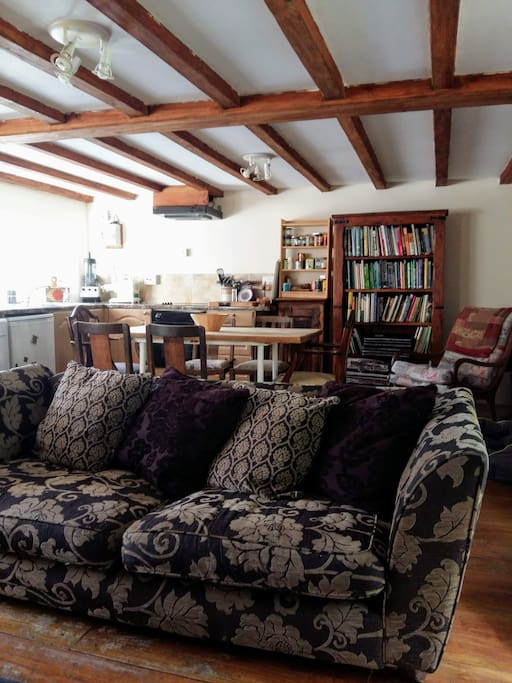 The open plan living space offers a large comfy sofa to cwtch up in.