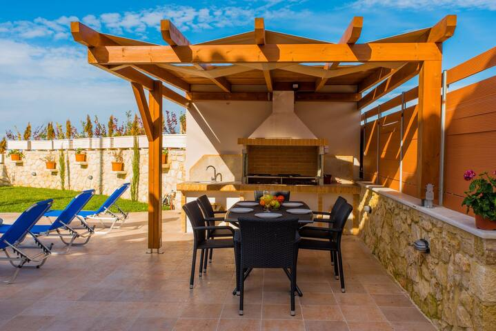 BBQ facilities are available outdoors, as well as a dining area under a shaded pergola!