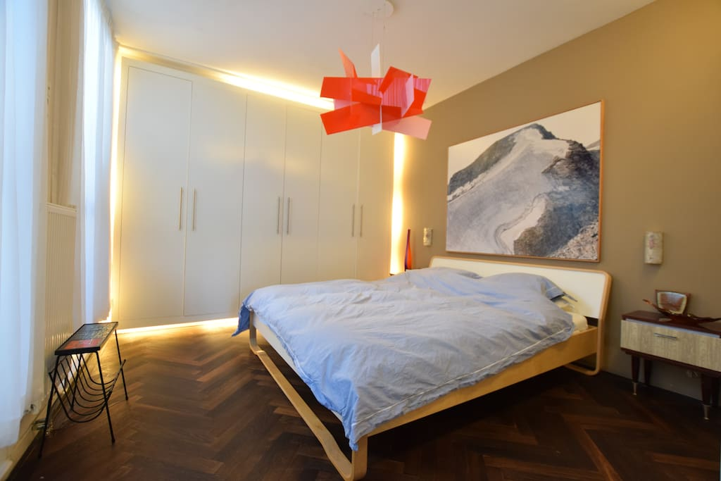 Big bedroom with comfortable bed