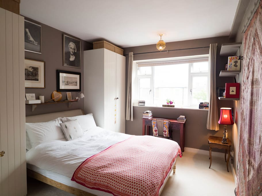 Main bedroom with large double bed.