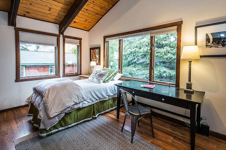 This bedroom has one twin plus a desk. It is located on the main level with the kitchen and shares a full bath