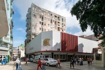 We are at Artehabana building. There is an Art Store downstairs, and a market crossing the street. Unlike in the photo, the street is usually with no vehicles. The cross street is Boulevard San Rafael. It is a safe area to walk, and wander.
